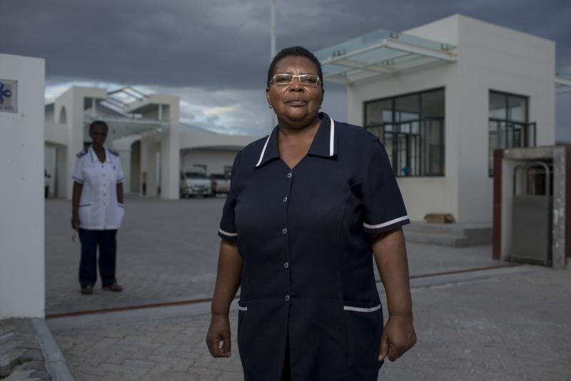 """Naomi Nanus, 64. Omuthiya District Hospital, Namibia. Without exception, each of the unretired nurses interviewed for this story said that for them, nursing is a calling—something they felt they had to do to help people. """"It's not about what you do with your hands,"""" Nanus says. """"It's about how you care with your heart."""" Photo by Morgana Wingard for IntraHealth International."""