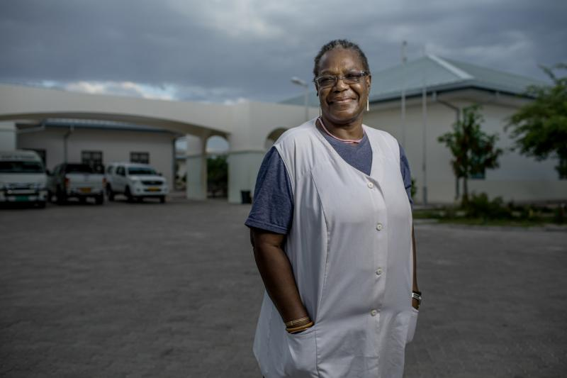 """Olivia Nandy, 68. Omuthiya District Hospital, Namibia. When Nandy's daughter died at age 36 of AIDS-related causes, she says, """"it hurt me very much. I decided then that the people who come after my daughter must not die. I must take care of them. Wherever I am going, I must take care of those people."""" Photo by Morgana Wingard for IntraHealth International."""
