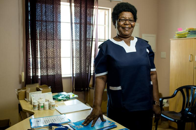 """Paulina Haugo, 67. Omuntele Clinic, Namibia. Nicknamed Kuku, or grandmother, Haugo is highly revered in her community. Not only is she considered elderly at 67, but she's also a head woman in her village, an elder in her church, and a highly skilled nurse. """"Even the men listen when she talks,"""" her colleagues say. Photo by Morgana Wingard for IntraHealth International."""