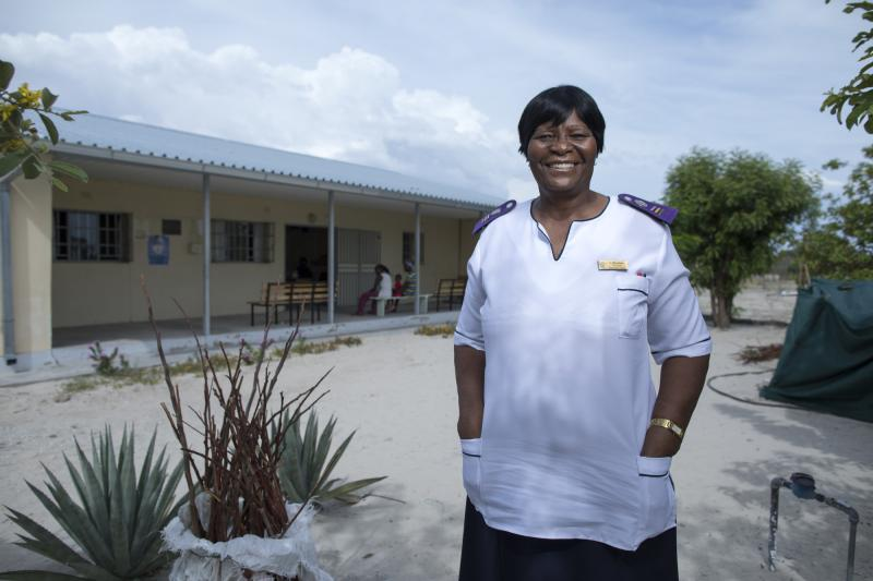 """Sofia Mbandeka, 64. Olukonda ARV Clinic, Namibia. """"These patients like to be treated by older nurses,"""" she says. """"Older nurses have more patience to listen to patients."""" Photo by Morgana Wingard for IntraHealth International."""